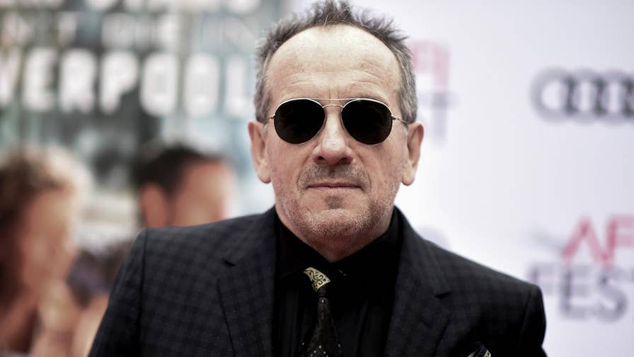 Elvis Costello announced Friday he canceled the rest of his European tour following a surgery to remove a 'small, but very aggressive' cancerous tumor. Costello underwent the surgery in May and continued to perform but now said he needed time to recover.