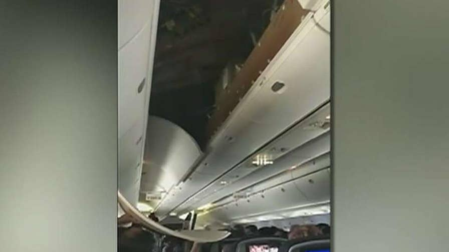 United Airlines issues apology to passenger is hit with a ceiling panel during landing.