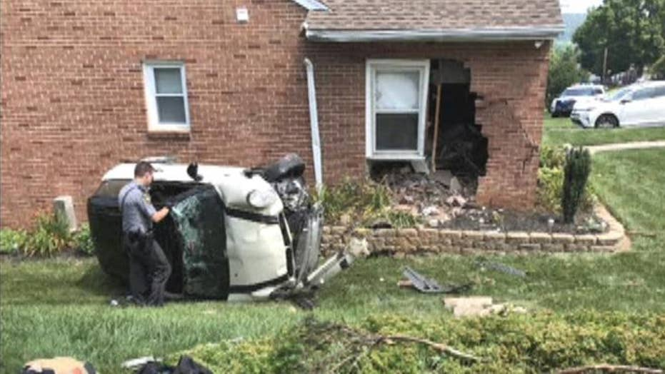 Raw video: Driver fleeing police crashes into house