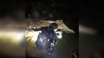 Crews in a race against time to bring remaining members of youth soccer team and their coach out of the cave complex they've been trapped in for more than two weeks; Jeff Paul reports from Chiang Rai, Thailand.