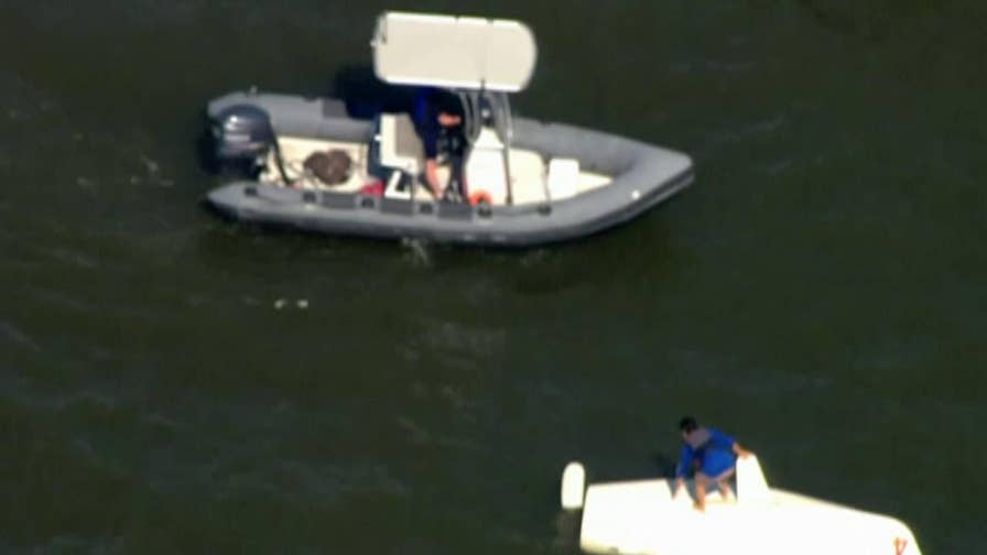 Raw aerial footage shows the moment that a man was rescued from his upside-down boat in the Hudson river.