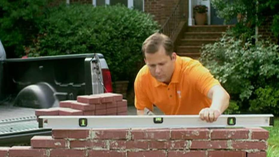 Republican congressional candidate builds wall in new ad