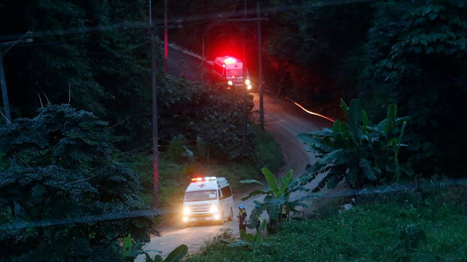 4 players, coach remain trapped in Thailand cave