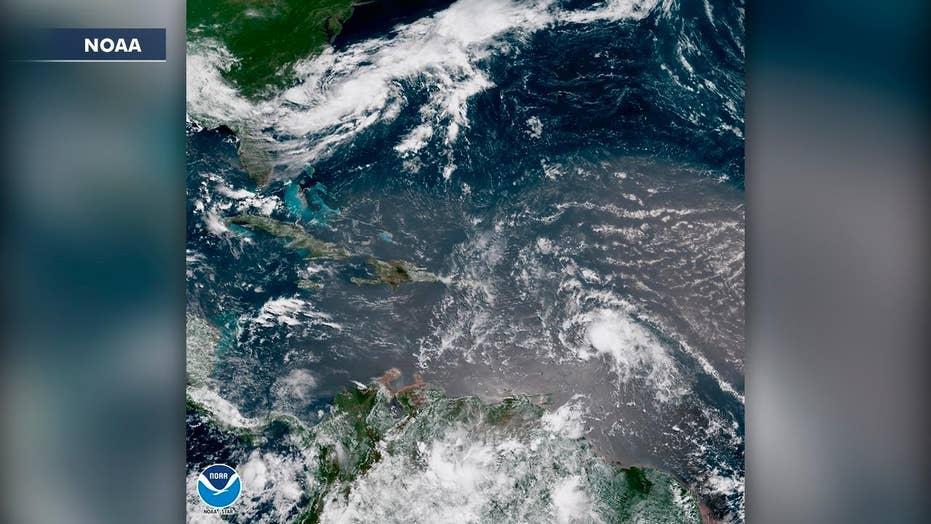 Beryl downgraded as Tropical Storm Chris gains strength