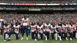 The National Football League and its players association announced Thursday that the league would hold off on enforcing its new national anthem policy while the two sides attempt to resolve the issue.
