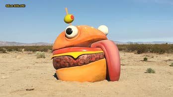 A giant real-life version of the 'Durr Burger' sign featured in the wildly popular video game 'Fortnite' has been found in the Mojave desert. The sign's appearance in the real-world is sparking chatter that the strange desert burger is some sort of marketing stunt.