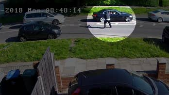 London Police released shocking footage of a gunman's daylight attack on a driver sitting in stopped traffic. In the security video, the masked man fired three shots at point blank range through the driver's side window.