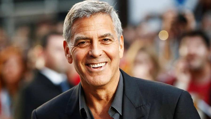 Actor hit by car while riding motorbike on way to film set on the island of Sardinia in Italy. Clooney's injuries were not believed to be serious.
