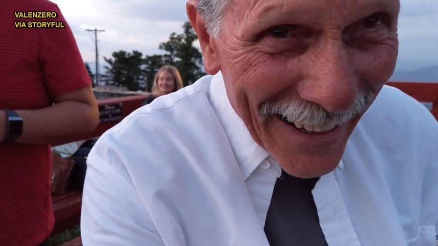 John Hart, a New Mexico grandpa, looked overjoyed to be tasked with recording a couple's proposal, but what he didn't realize was that the camera was on selfie mode and he recorded his own reaction, instead.