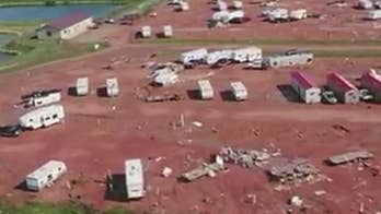 Deadly twister destroyed more than 100 homes.