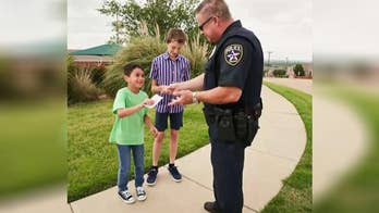 7-Eleven's program is designed to connect law enforcement with communities; officers 'ticket' children for good behavior.