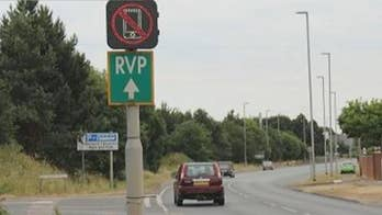 County outside London testing out road signs using scanning technology to detect radio signals from cell phones in effort to crack down on distracted drivers.