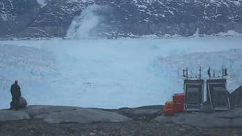 Raw Video: NYU scientists capture video of a four-mile iceberg breaking away from a glacier in Greenland.