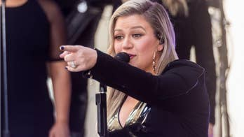 Kelly Clarkson trips before singing national anthem at Indy 500