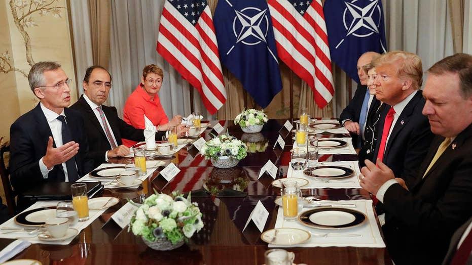 Trump kicks off NATO summit with testy breakfast meeting