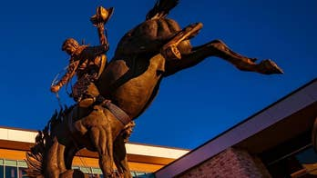Critics say the university's new slogan, 'the world needs more cowboys,' is sexist, racist.