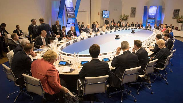 NATO agrees to pay fair share for defense