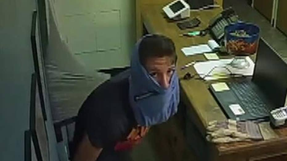 Raw video: Burglary suspect wears boxer briefs on head