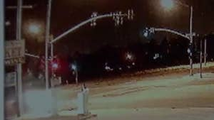 Raw video: Surveillance camera captures the moment as the woman is hit while crossing the street. Police are searching for clues to the identity of the driver.
