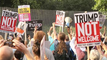 Angry protesters pack Trafalgar Square during the president's visit; Benjamin Hall reports from the scene.