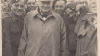 Photographs of Winston Churchill greeting troops shortly after D-Day have surfaced.