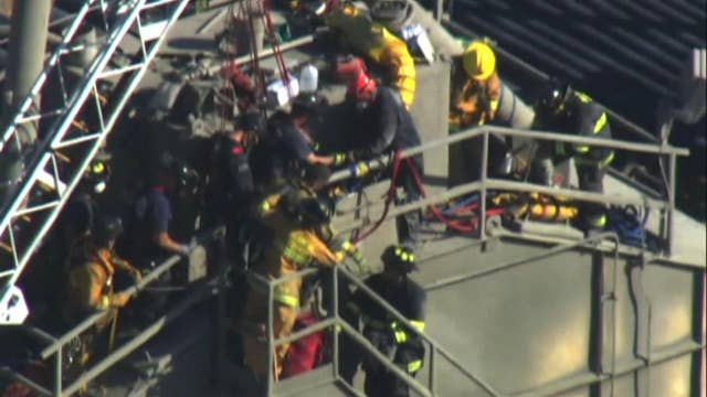 Raw video: Crews work to free a man trapped in cement