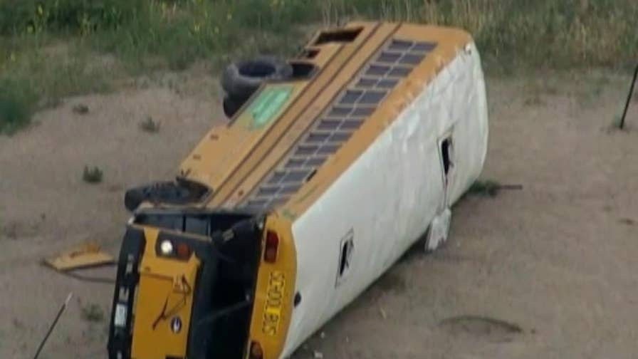 Officials say the bus collided with a truck, causing it to flip on its side. The number or extend of injuries is unknown.