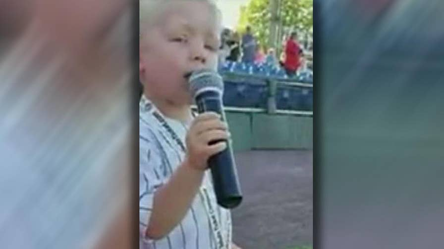 Three-year-old boy impresses crowd with his performance of the national anthem.