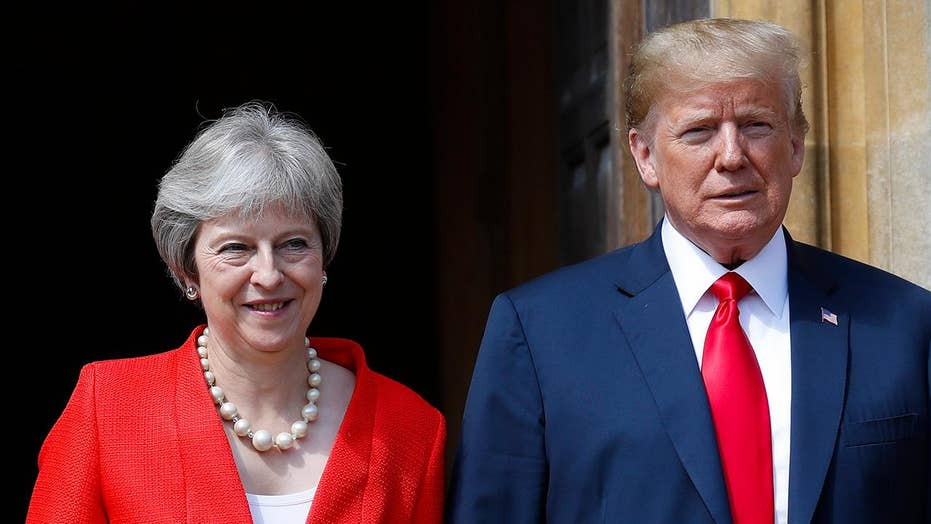 Theresa May says Trump advised her to sue the EU