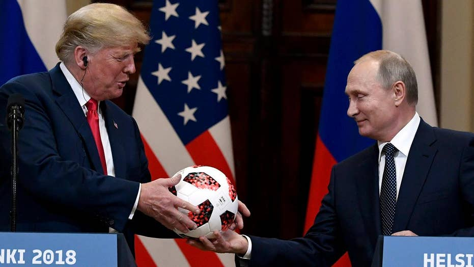 Soccer diplomacy? Putin passes World Cup ball to Trump
