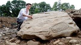 Archaeologists in Ireland have uncovered a megalithic tomb containing two burial chambers, complete with elaborate carvings.