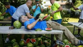 He sliced a total of 26 watermelons on his stomach with a team of helpers.