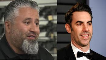 Watch a California gun store owner who says he confronted a disguised Sacha Baron Cohen