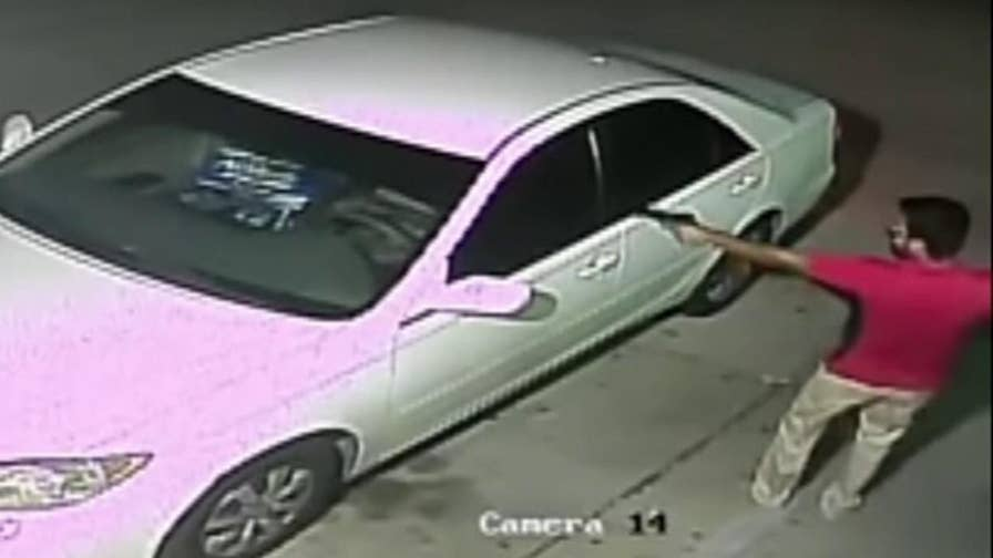 Raw security footage shows the man escaping in his car with three 18 packs of Natural Ice beer.