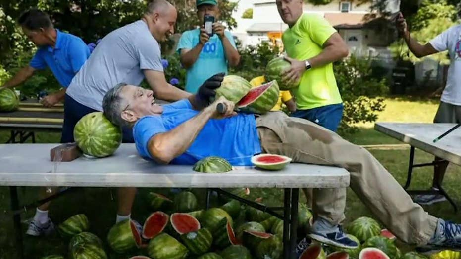 Man sets records for slicing watermelons on his stomach