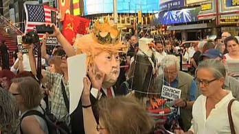 Demonstrators gather in Times Square to protest President Trump.