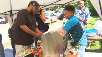 13-year-old Jaequan Falknew received an official business permit with help from the Minneapolis Health Department to sell hot dogs to his community.
