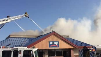 Watch as firefighters battle an inferno at a Fort Worth, Texas IHOP.