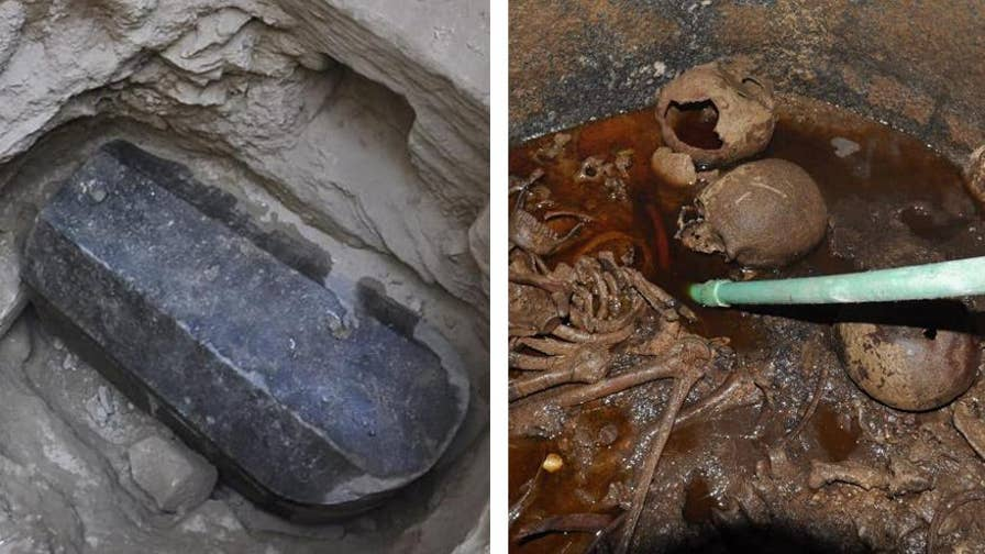 Archaeologists in Egypt have opened a massive black sarcophagus that is said to be 'cursed.' Inside they found three skeletons that will be studied.