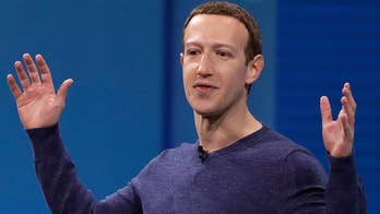Facebook CEO under fire for defending the social media giant's decision to not to ban offensive content, including those denying the holocaust.