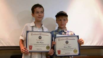 Two Massachusetts boys are honored with award after helping a swimmer in distress.