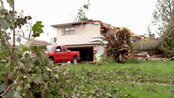 Residents of Marshalltown, Iowa work to rebuild after tornadoes cause significant damage.