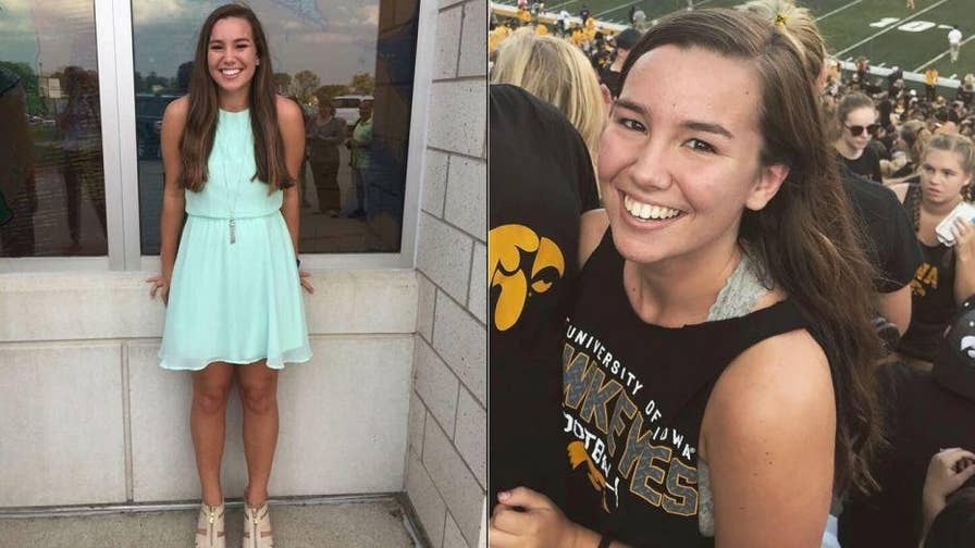 Authorities search for University of Iowa student Mollie Tibbetts who was reported missing after going on an evening jog.