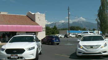 Police in Utah search for man who stole a car with two children in the backseat.