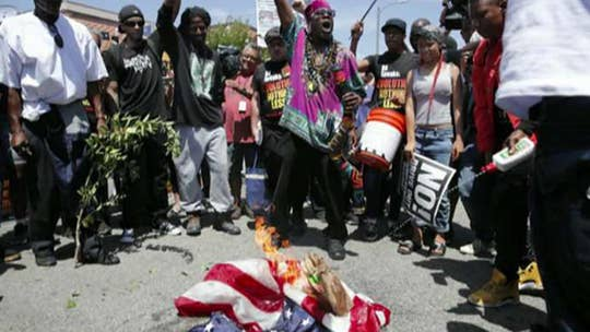 Counterprotesters burn and stomp an American flag outside the Democrat's California office; former Navy SEAL Dan DeBono reacts.