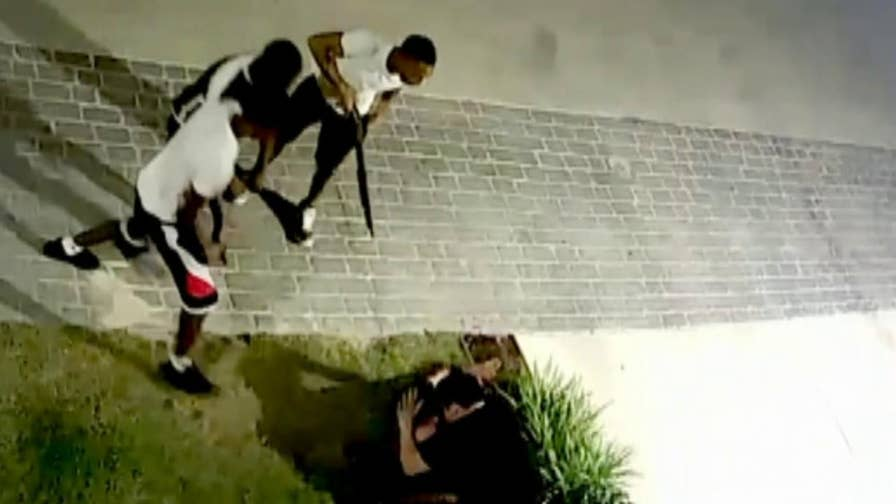 Security cameras recorded three armed robbers attacking the couple while they walked their dog.