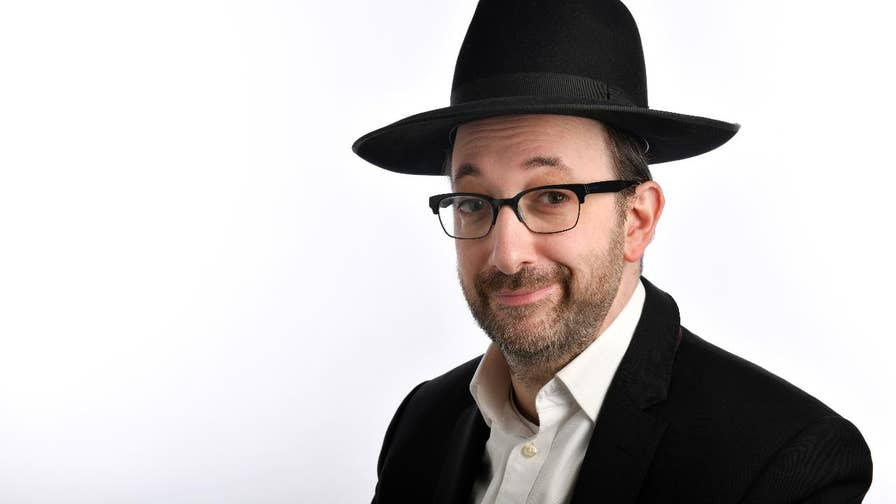 Ashley Blaker, the U.K.'s only Orthodox Jewish comedian, tells Fox News how he works in television without owning one.