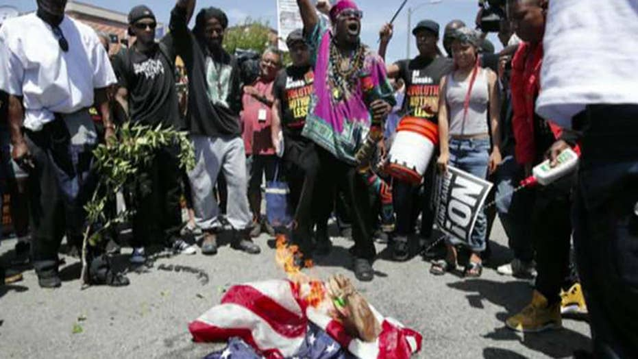 Protesters burn American flag outside Maxine Waters' office