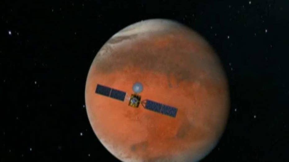 Scientists say huge lake of salty water buried on Mars