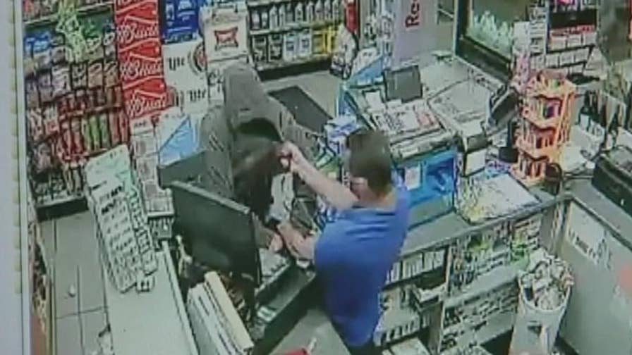 Security footage catches Ebrahim Gawargi fighting back a robber with his highly honed martial arts skills.